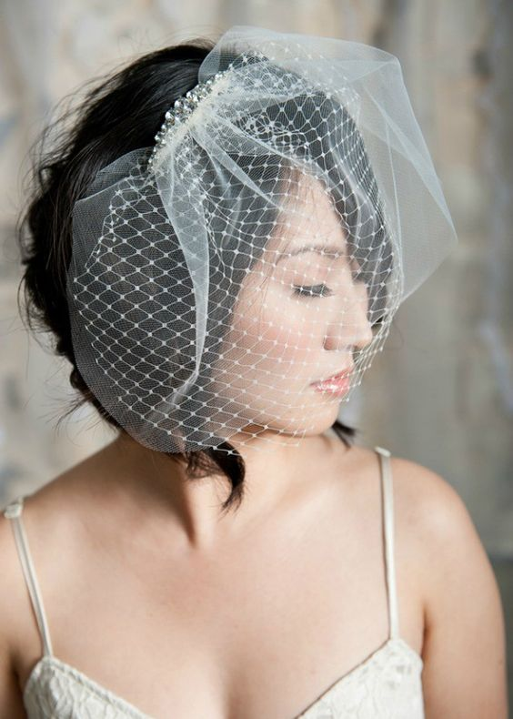 Birdcage Veil - Light and short veils cover half of the face. These veils can be part of a hat or a beautiful hair clip, or an independent veil can be attached to hair using hairpins. | www.rossiniweddings.com