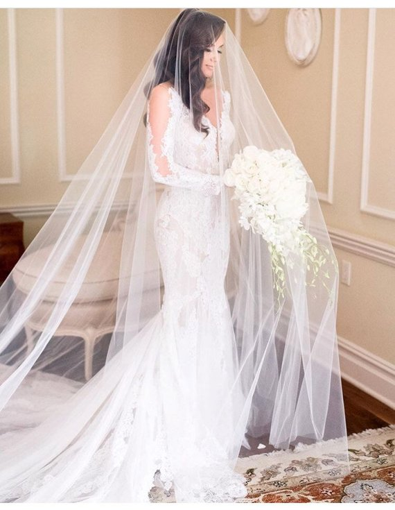 Cathedral Veil - These statement pieces not only reach the very bottom of the dress, but stretch further out to form a long train.  | www.rossiniweddings.com