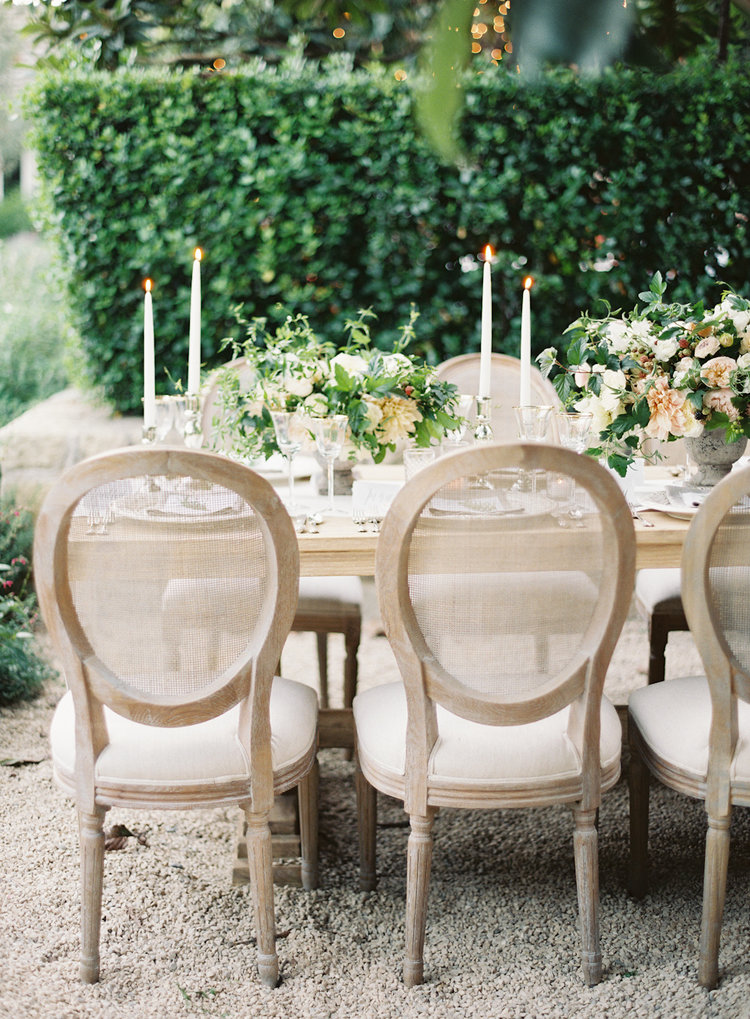 The antique-inspired caned back chair