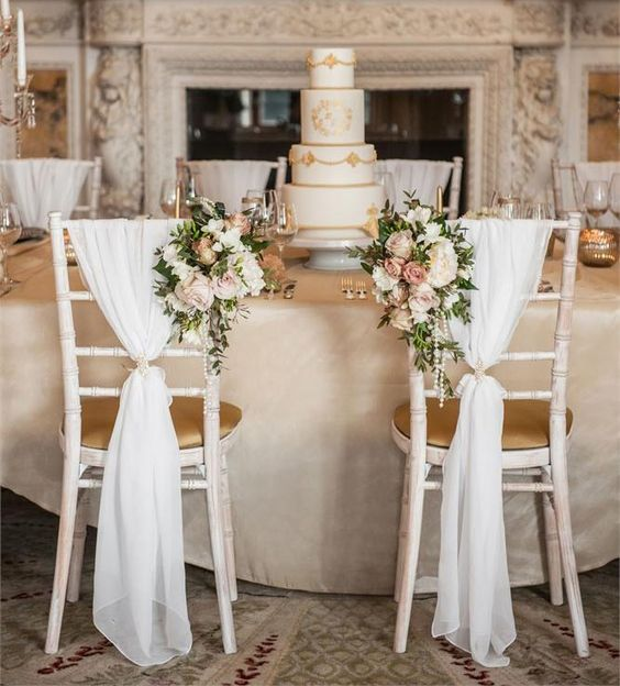 Decorate the back of your chiavari chair with soft fabric and florals