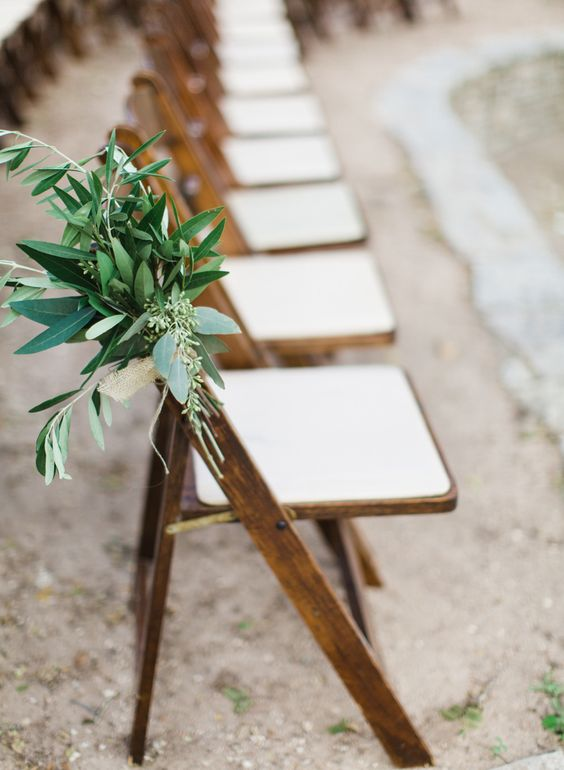 Folded chair paired with comfy cushion and greenery