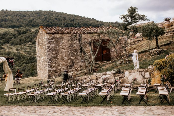 Stunning Tuscan wedding with slotted ceremony chairs