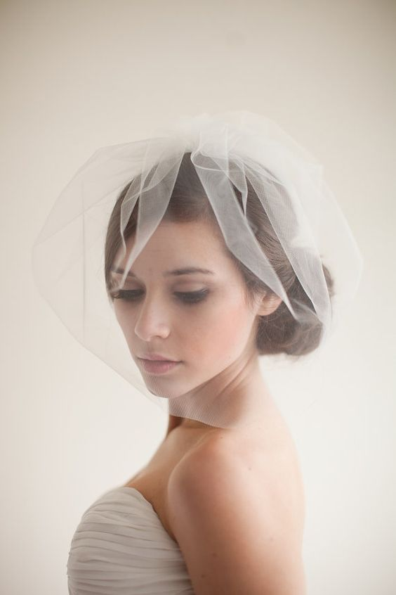 Light and short veils cover half of the face. These veils can be part of a hat or a beautiful hair clip, or an independent veil can be attached to hair using hairpins. | www.rossiniweddings.com