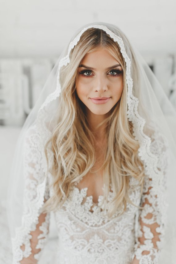 Mantilla Veil - This is a traditional Spanish veil, framed with lace around the edges.  | www.rossiniweddings.com